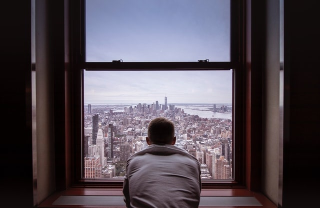 Man looking at the window