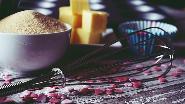 Whisk and baking ingredients with hearts