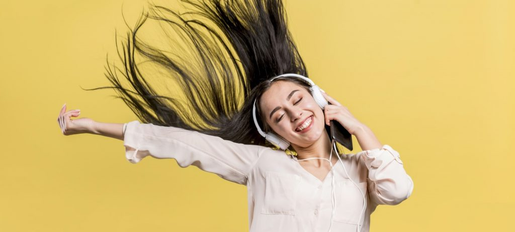 Girl listening to Music to Improve her English Listening Skills